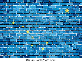 Flag of Alaska on a brick wall