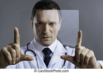 Handsome doctor posing with medical glass