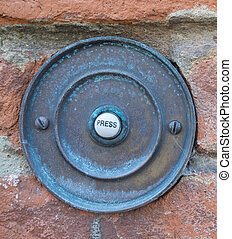rusty door bell - a rusty door bell with the writing press
