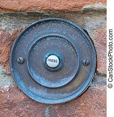 rusty door bell - a rusty door bell with the writing press
