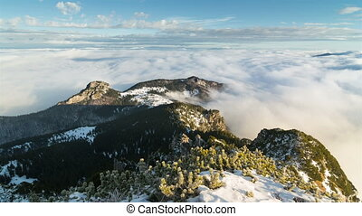 Epic winter morning above clouds in foggy mountains time lapse