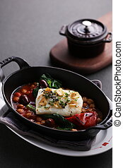 Steamed Atlantic cod saffron braised with bean on black stew