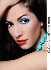 Brunette with turquoise beads