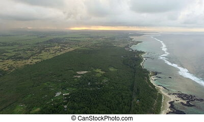 Aerial bird eye view of coast with sand beach and palm trees and water of Indian Ocean, Mauritius Island