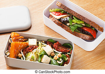 Lunchbox salad with pumpkin chickpeas and a sandwich with...