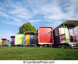 Multi color caravans against blue sky