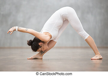 Beautiful Yoga: Pyramid pose - Portrait of beautiful young...