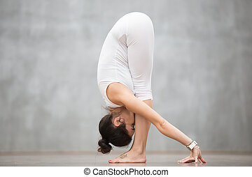 Beautiful Yoga: Uttanasana pose - Portrait of beautiful...