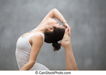 Beautiful Yoga Backbend - Young pretty woman with tattoo on...