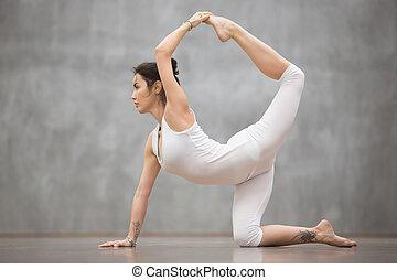 Beautiful Yogi woman doing chakravakasana pose - Side view...
