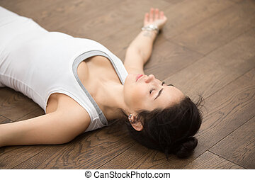 Beautiful Yoga: resting after practice - Side view portrait...