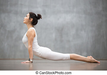 Beautiful Yoga: Upward facing dog pose - Beautiful young...