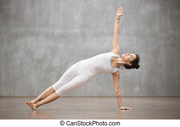 Beautiful Yoga: Side Plank posture - Side view portrait of...