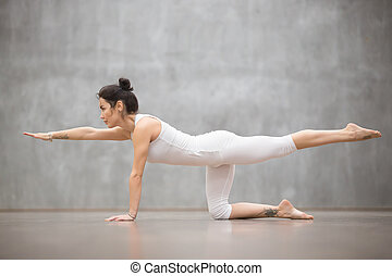 Beautiful Yogi woman doing Bird dog pose - Side view...