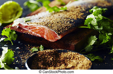 Garam masala salmon pepper with herbs on wooden table