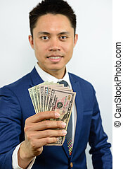 hand carrying currency note spread out - A smiling asian man...
