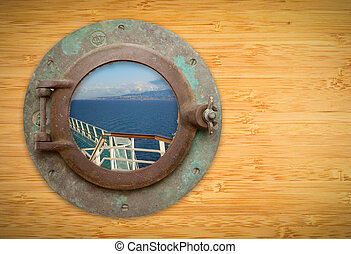 Antique Porthole on Bamboo Wall with View of Ship Deck...