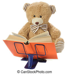 Stuffed bear reading a book - Image of a stuffed bear...