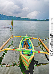 Asian canoe on the lake Bratan(Bali, Indonesia)