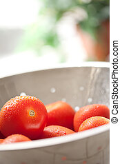 Fresh, Vibrant Roma Tomatoes in Colander with Water Drops