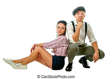 young man in a cap and woman in shorts - Image of a young...