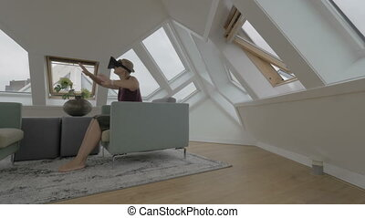 Woman entertaining with VR-headset in Cube House - Young...