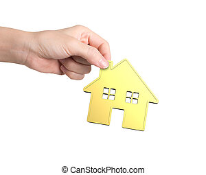 Hand holding golden house, isolated on white background.
