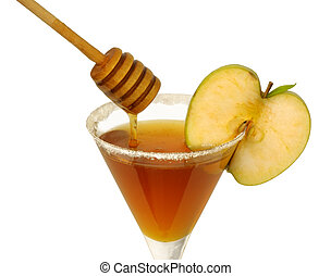 Rosh Hashana honey cocktail - Honey in a cocktail glass with...