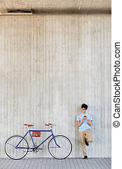 man with smartphone and fixed gear bike on street - people,...
