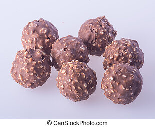 chocolate ball or chocolate bonbon on a background. -...