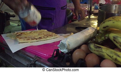 Thailand Hua Hin food market banana loti with cream and...