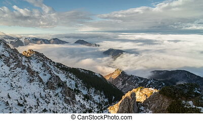 Epic foggy morning above clouds flows in winter mountains time lapse