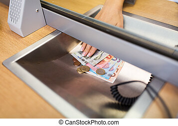 hand with cash money at bank office or exchanger - people,...