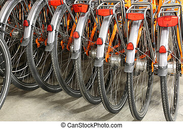 rear wheels and mudguard of orange bicycle - many of the...