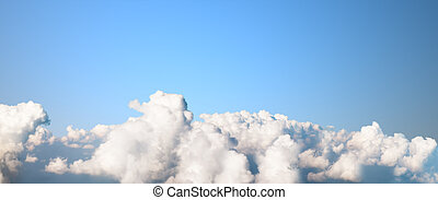 Clear blue sky over clouds