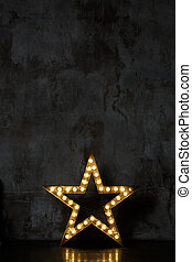 Star in black photo studio - Star with lamps in black photo...