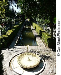 The Alhambra in Granada, Spain - Courtyard fountain in the...