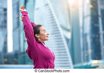 Attractive woman stretching her arms - Young sporty girl...