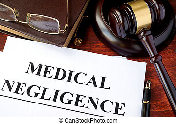 Medical Negligence form, documents and gavel on a table.