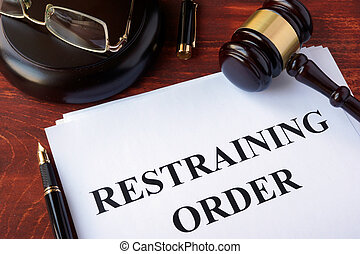 Restraining order and gavel on a table.