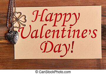 Heart-shaped pendant and greeting card. Happy Valentine's...
