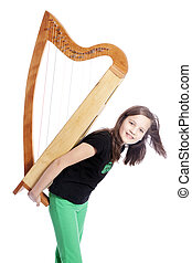 young girl in black shirt with harp on het back in studio...