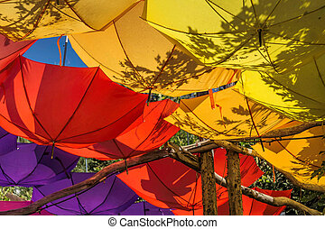 Upturned brightly colored umbrellas - Upturned bright and...