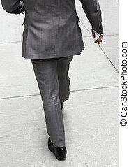 Manhattan street scene. Businessman in an elegant suit with...