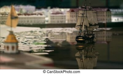 Sailing ship goes into port - brigantine sailing ship with...