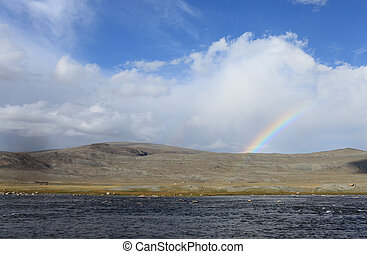 Rainbow in mountain landscape - Khoton Nuur lake Khoton in...
