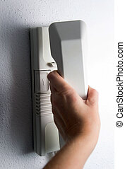 intercom - Hand holding headphone of entry phone