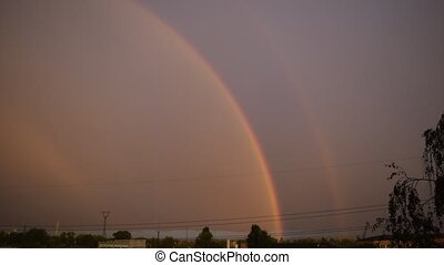 Double Rainbow on background of blue sky with the main and...