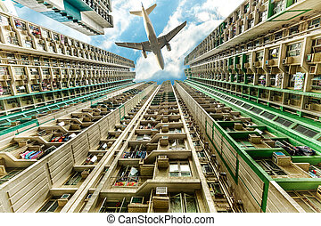 Airplane above residential district - Tall city buildings in...