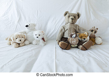 Group of cute stuffed animals on a white couch - A group of...